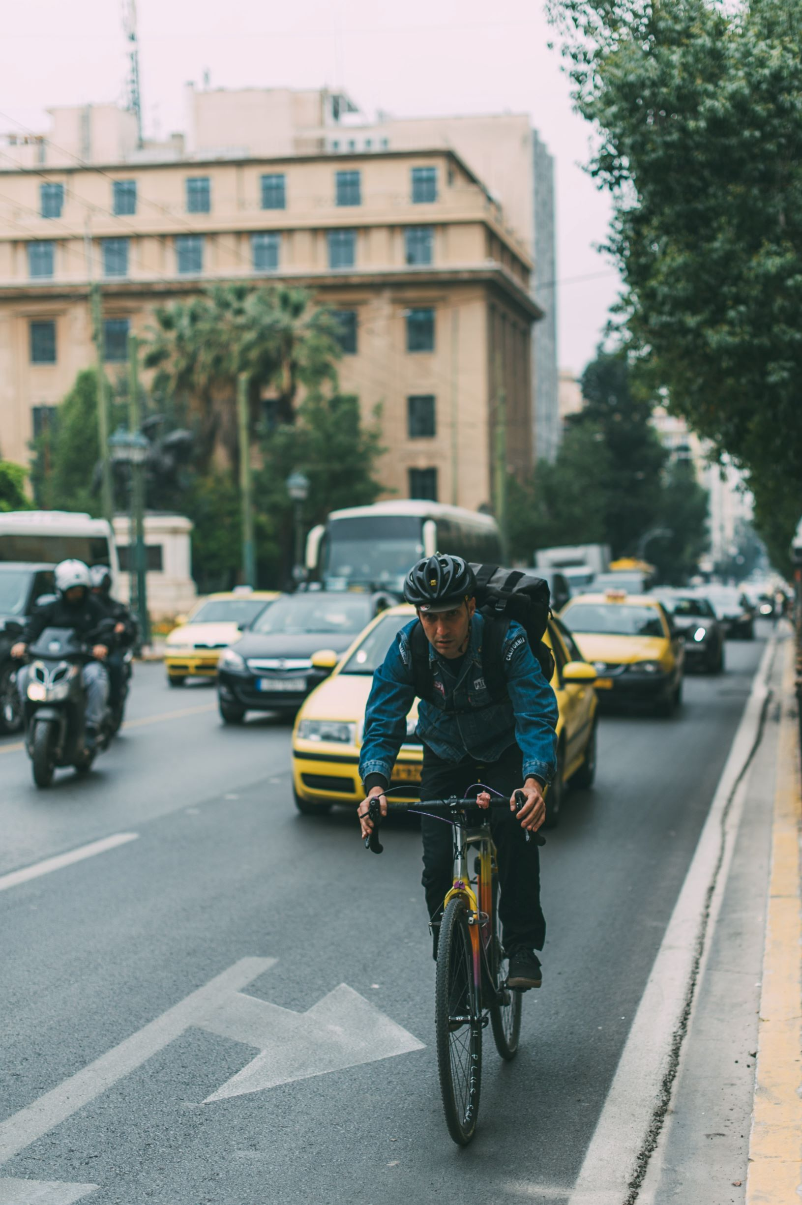 Photo of someone biking in the street