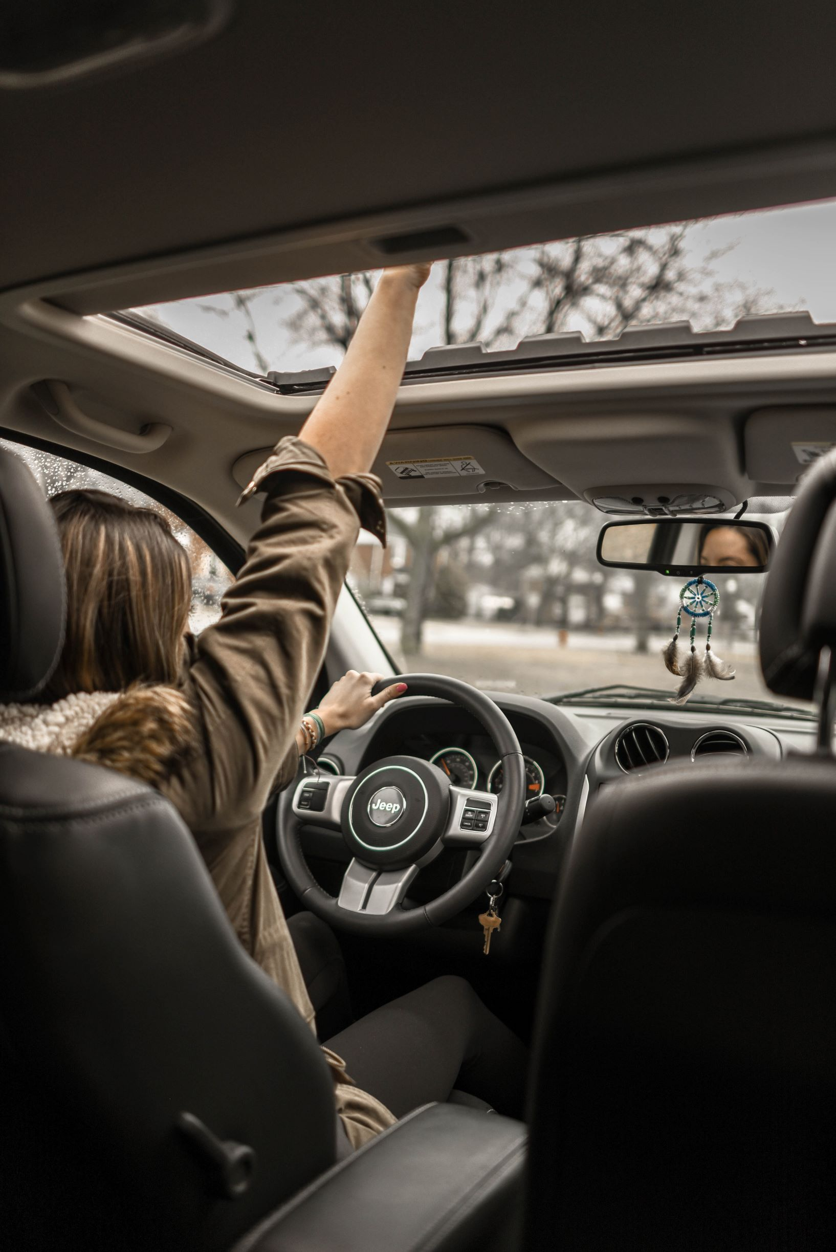 Woman driving a rented car