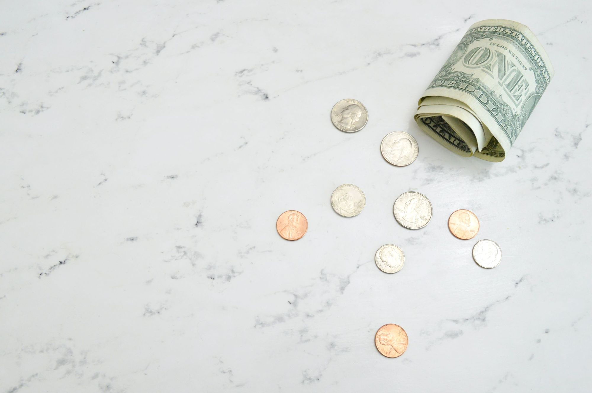 Photo of money being lost due to low insurance