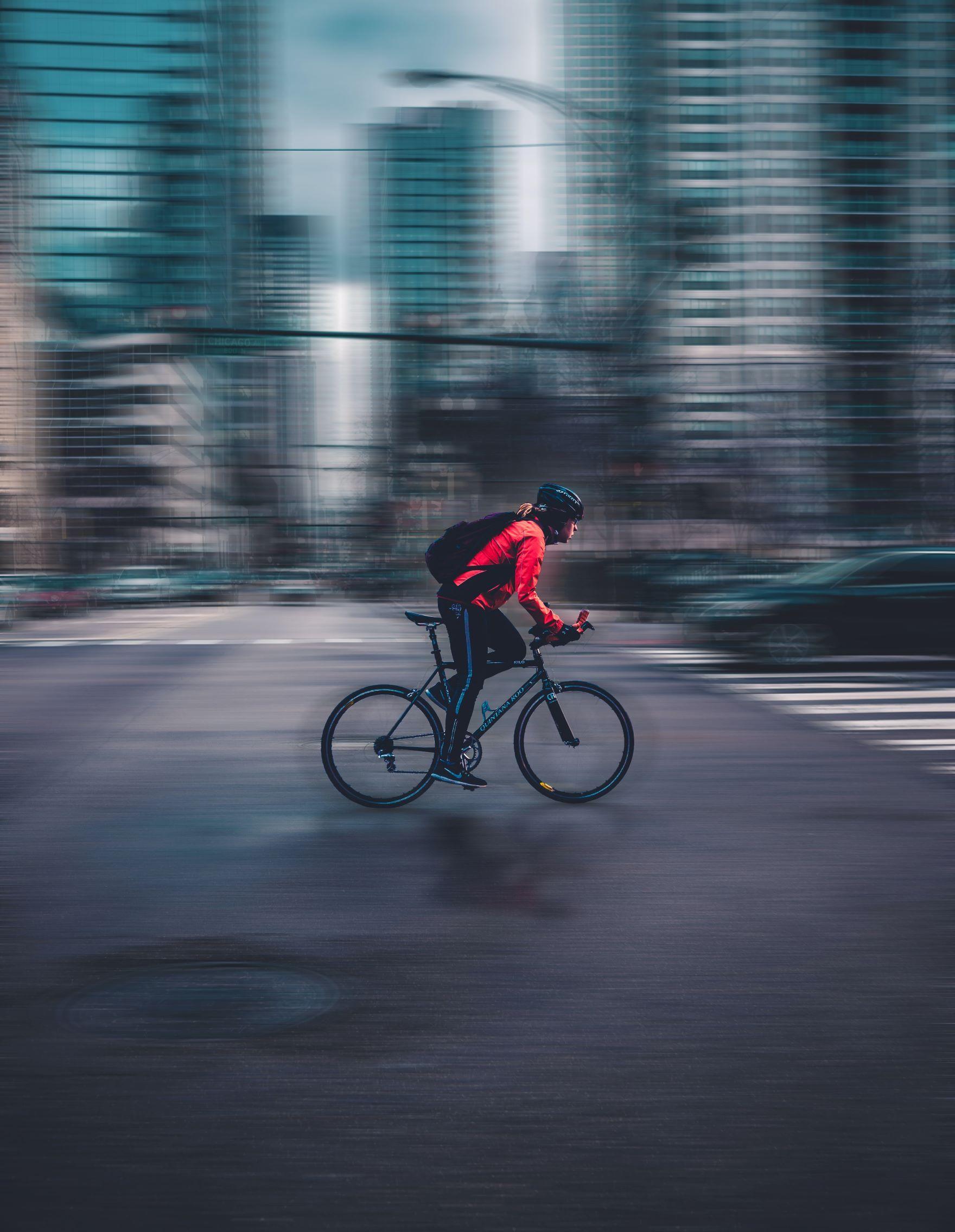 Photo of someone biking in the city