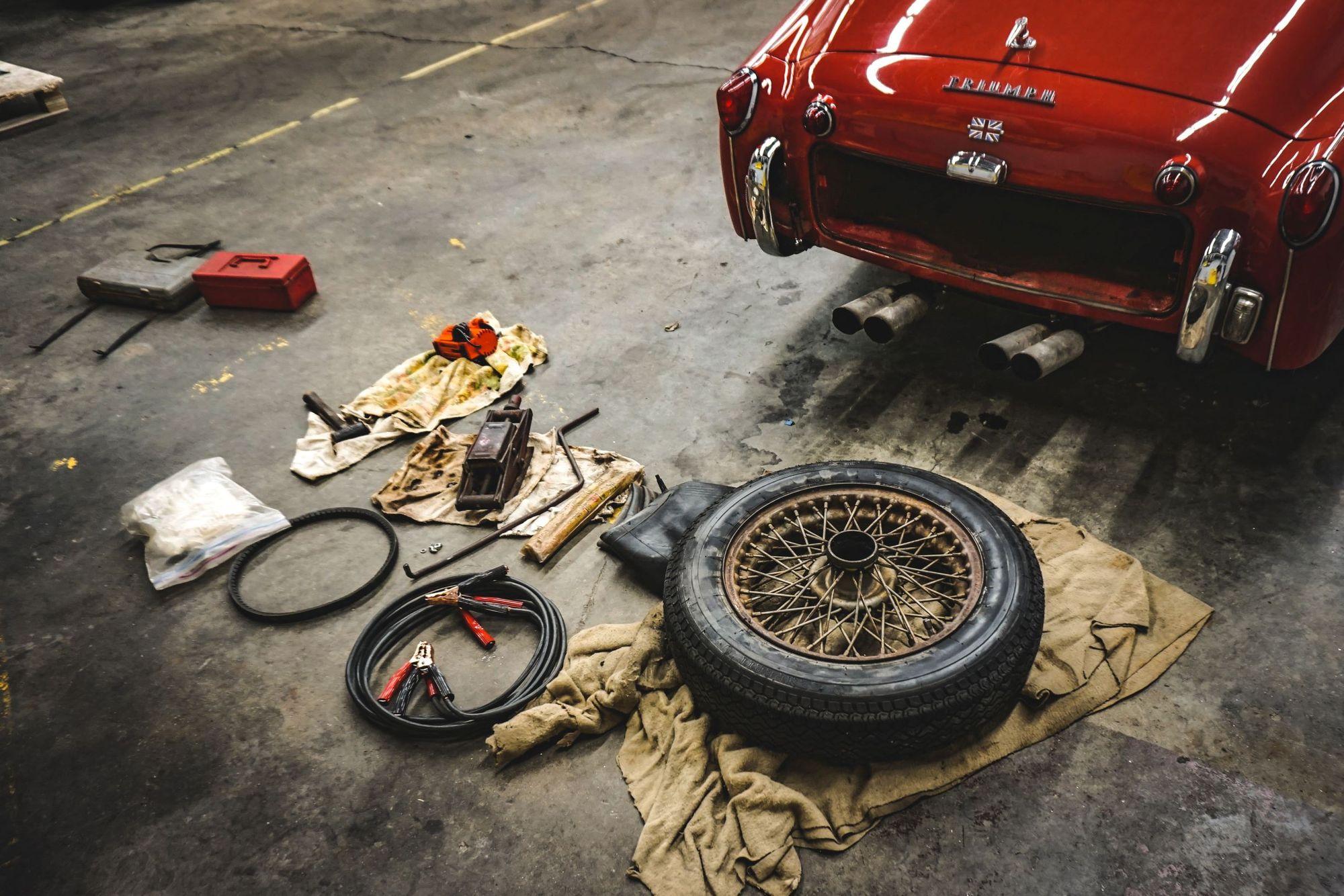 Photo of a car disassembled at a mechanic's repair shop